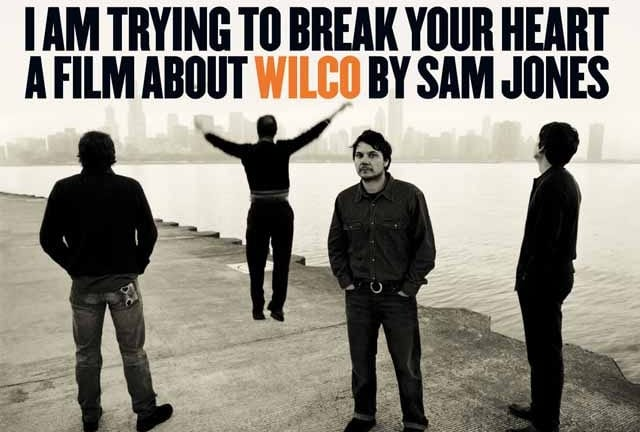 Wilco posing on a dock for the documentary film poster