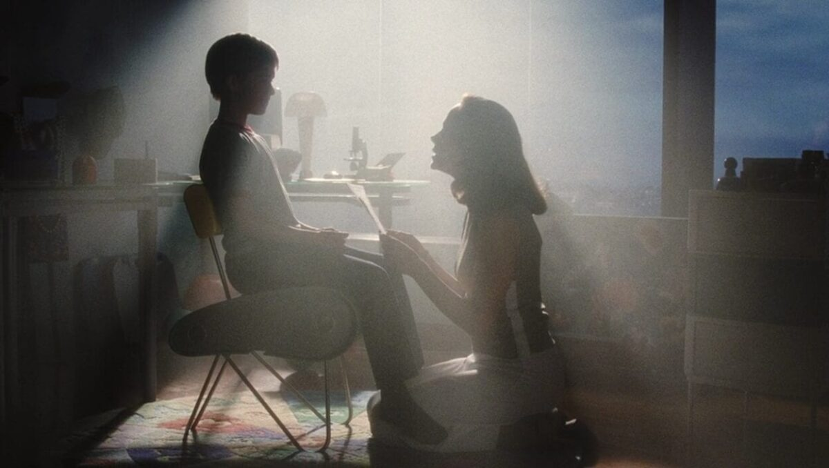 Monica programmes David as he sits in a chair in A.I. Artificial Intelligence