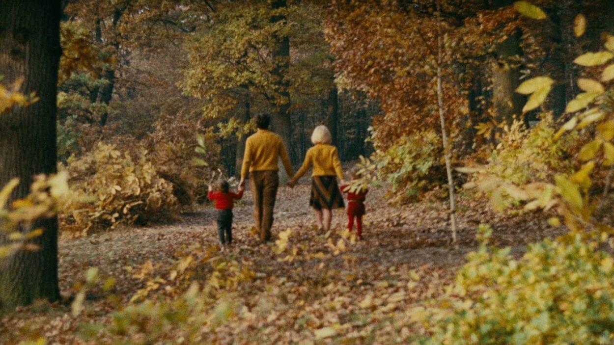 Francois with his children and new wife walking in the woods