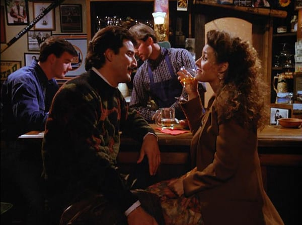Elaine and Keith Hernandez drink at a bar