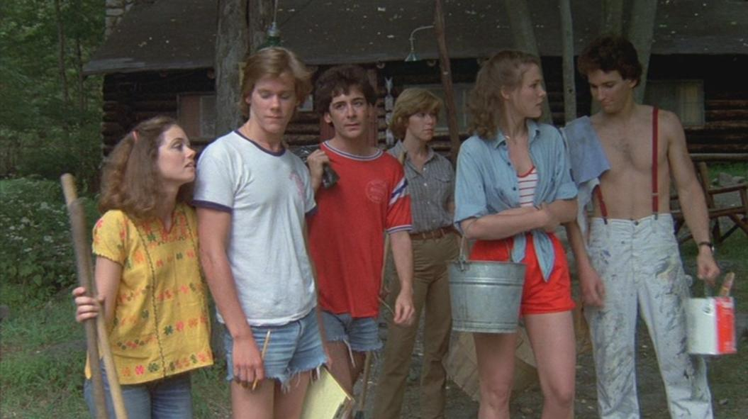 The Camp Crystal Lake counselors stand about, seemingly bored.