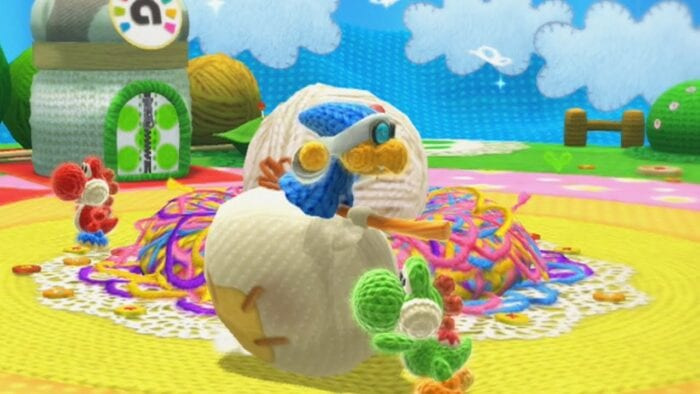 Yoshi confronts Kamek Koopa. Everything is made of yarn.