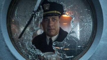 Ernest Krause gazes out of a broken porthole window.