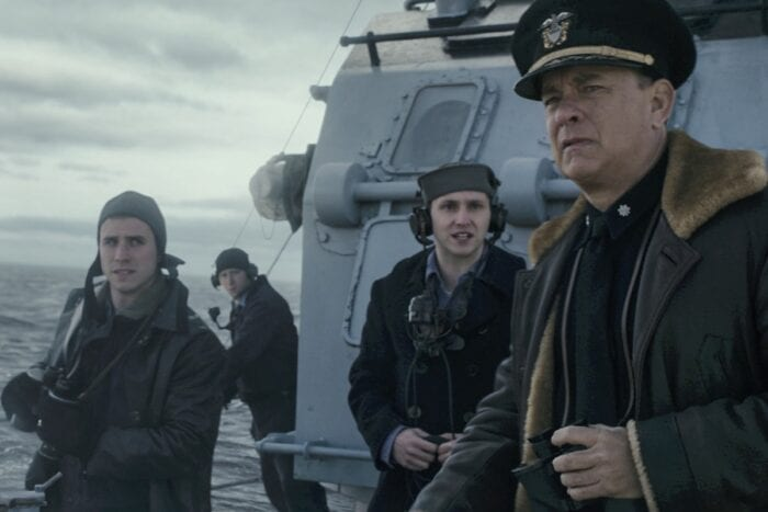 The lookout crew awaits orders from Ernest Krause as he looks ahead to sea.