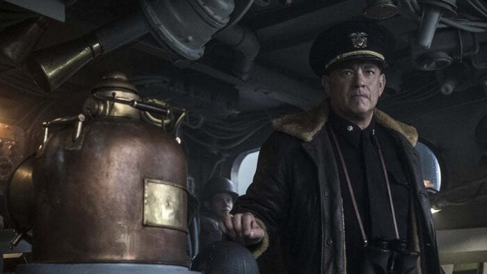 Captain Ernest Krause stands ready at the helm in his sheepskin jacket.