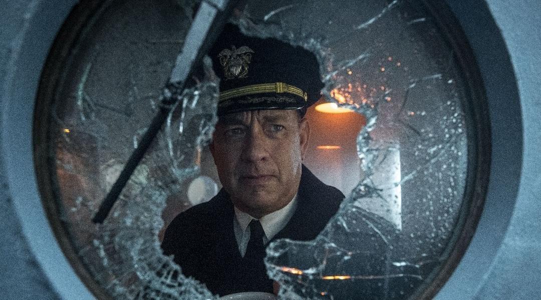 Ernest Krause gazes out of a broken porthole window.