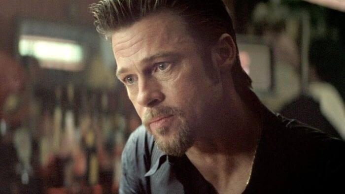 Brad Pitt leans into a bar conversation.