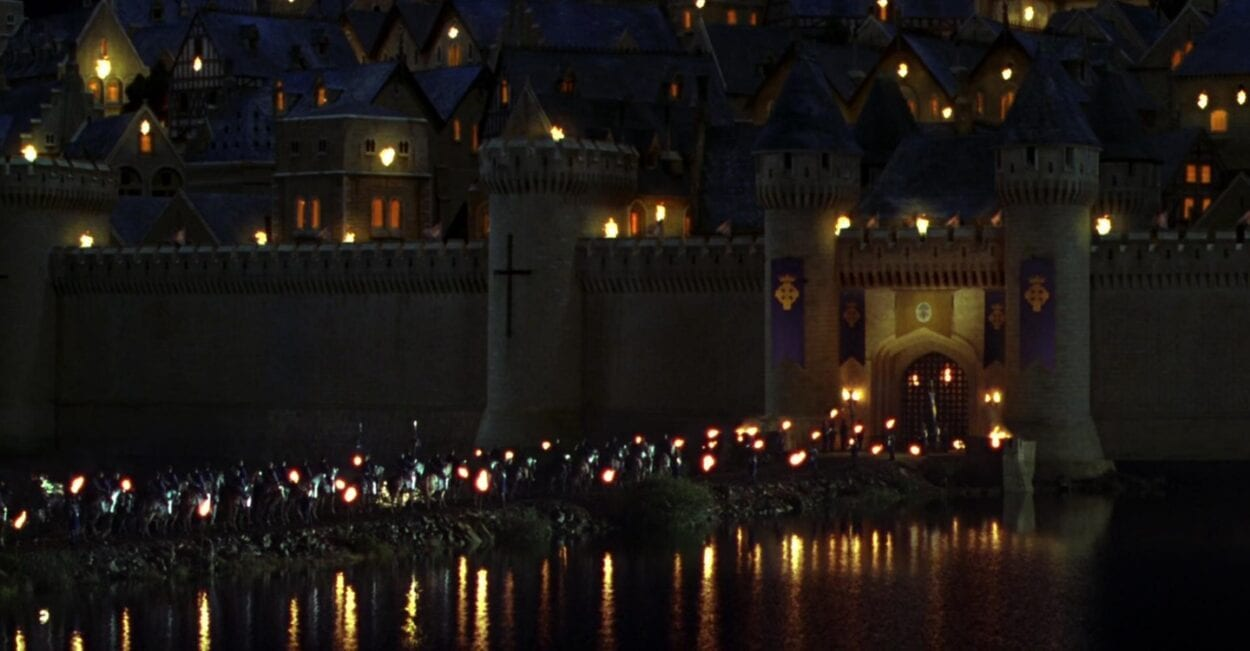 A caravan of soldiers and royalty arrive at Camelot