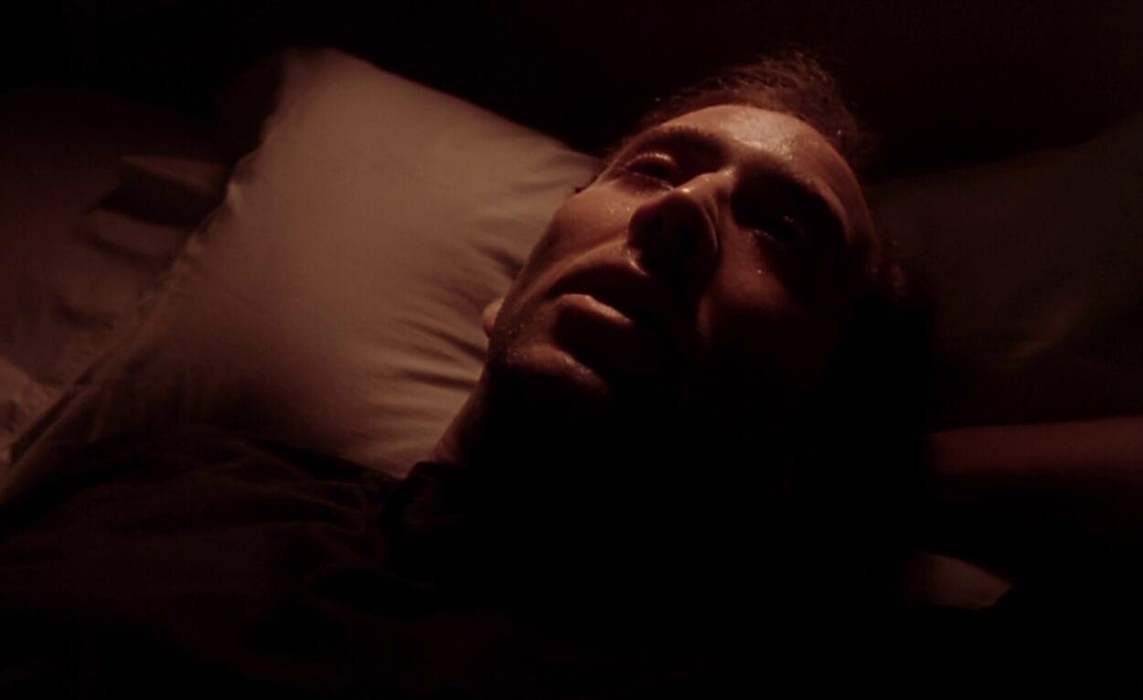 Ben lies in bed dead