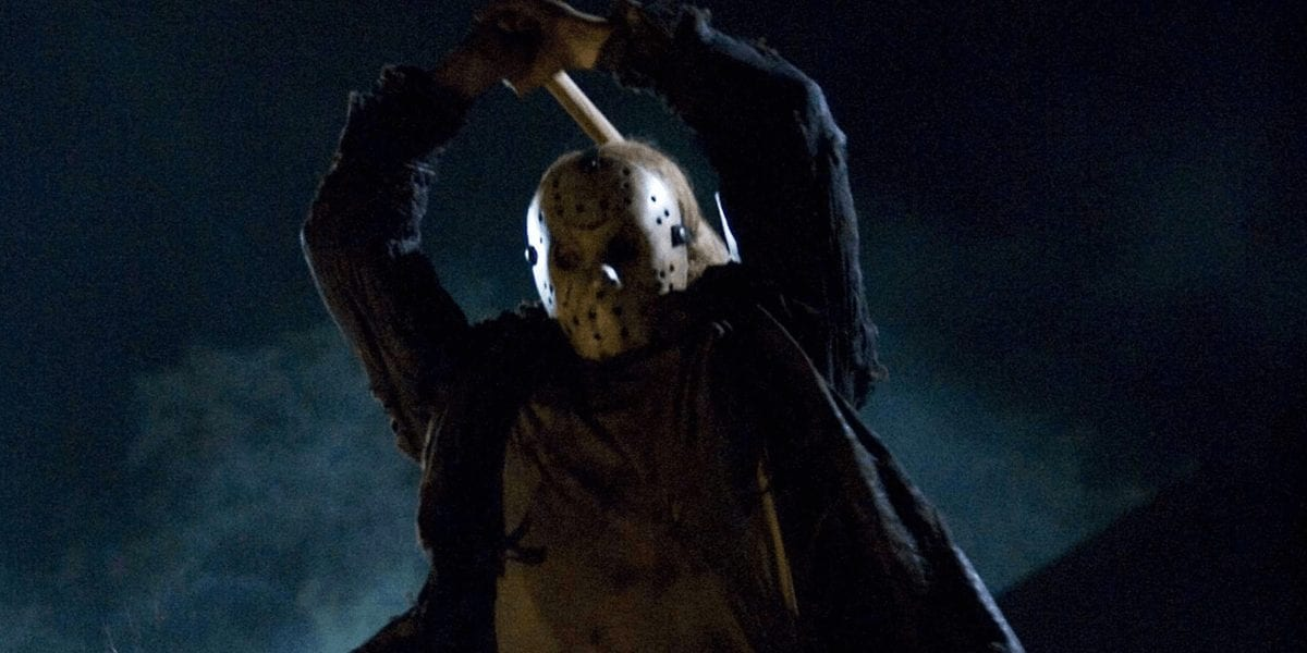 Jason wields a hatchet in the air, preparing to plunge it into his victim.