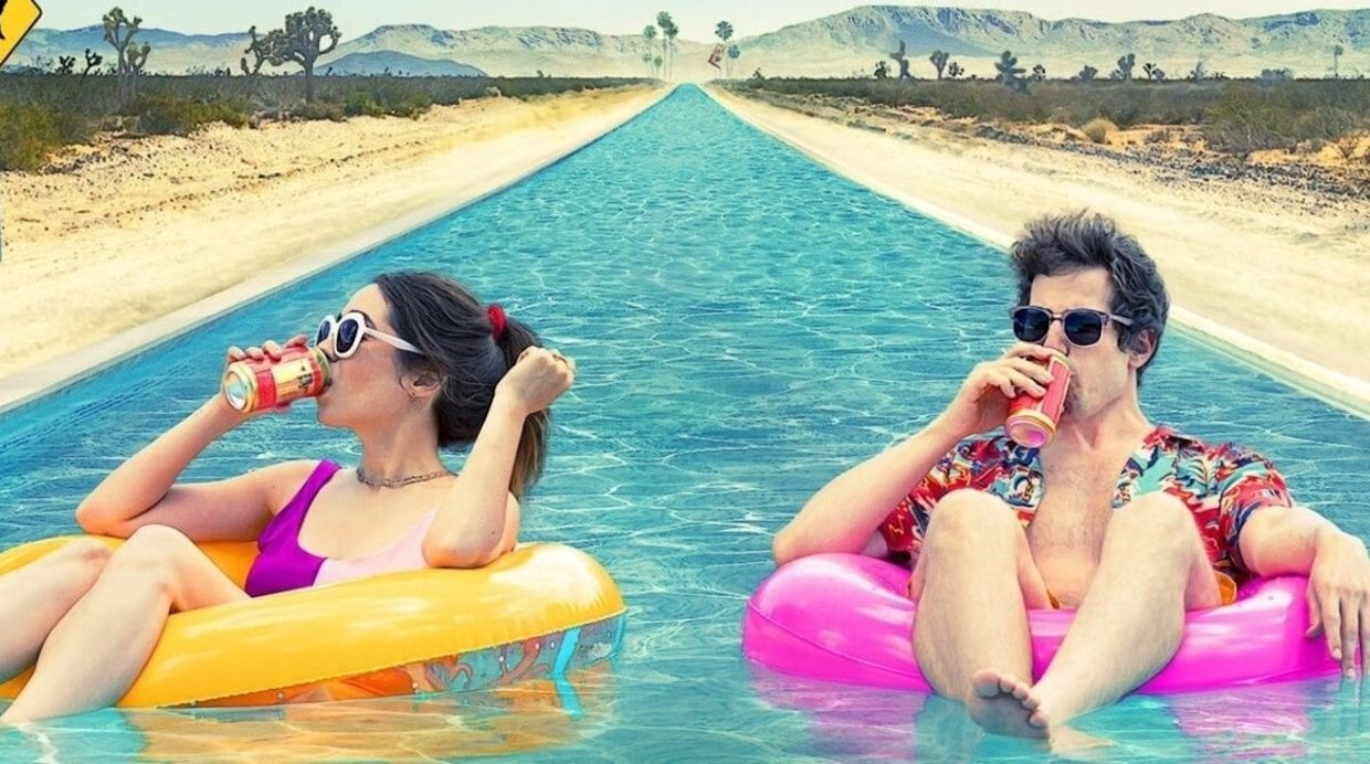 Nyles and Sarah drink while floating in a pool in Palm Springs