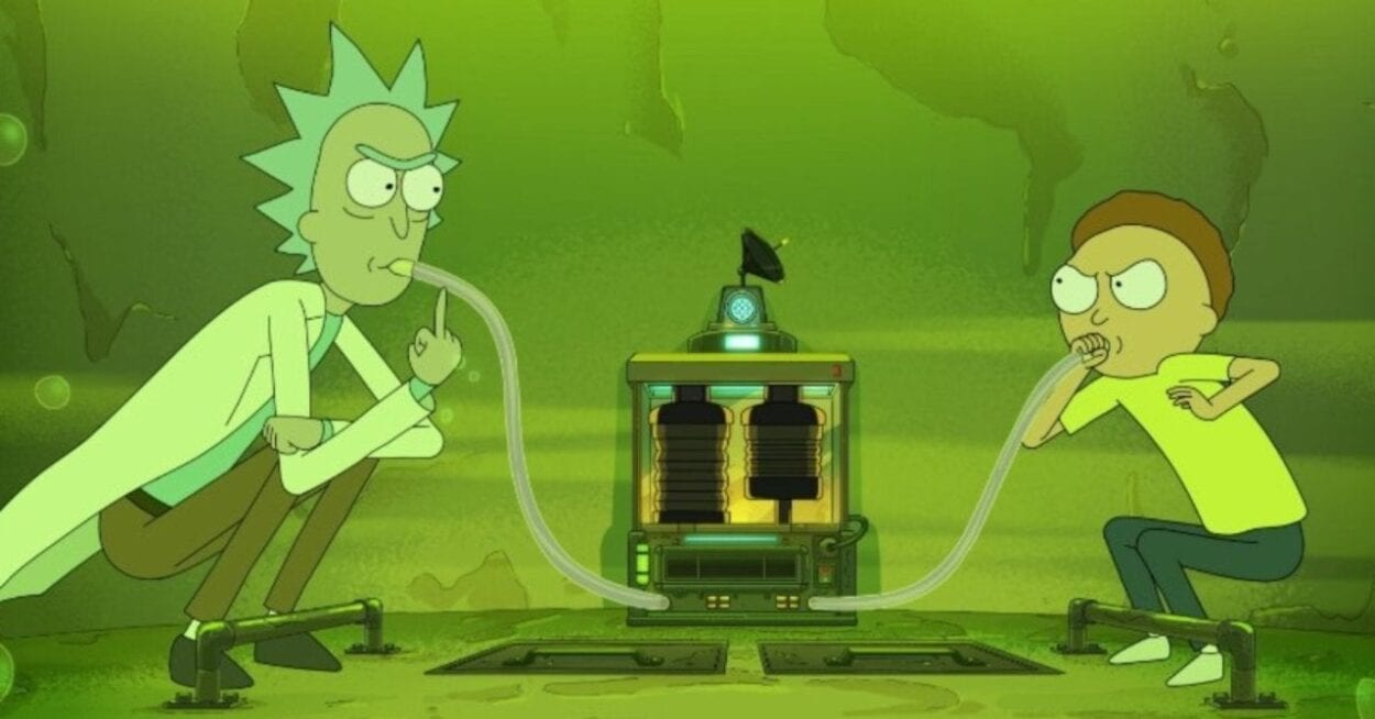 Rick and Morty glare at each other while submerged in the fake vat of acid.