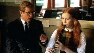 Glenn Holland advises a clarinet student through her practice.