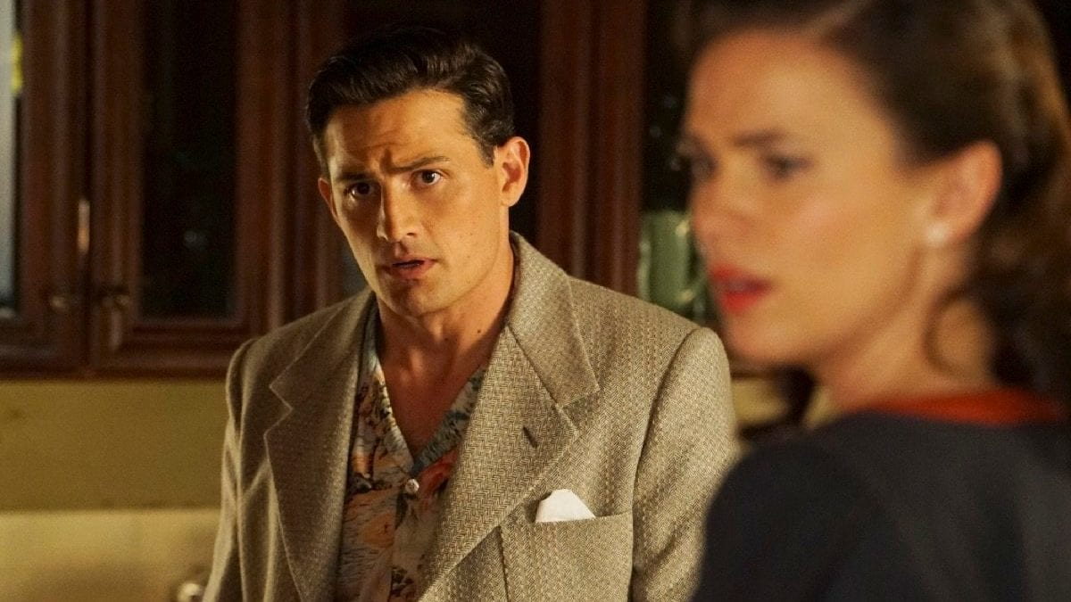 """Daniel Sousa (Enver Gjokaj) and Peggy Carter (Hayley Atwell) look off in the distance in """"Agent Carter."""""""