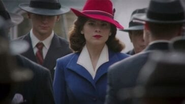 "Peggy Carter (Hayley Atwell) walks through a crowd of men in the opening scene of ""Agent Carter."""