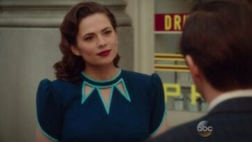 Peggy Carter (Hayley Atwell) looks on in Agent Carter.