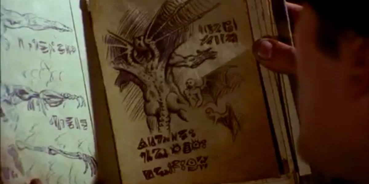 Guy is holding a demon book