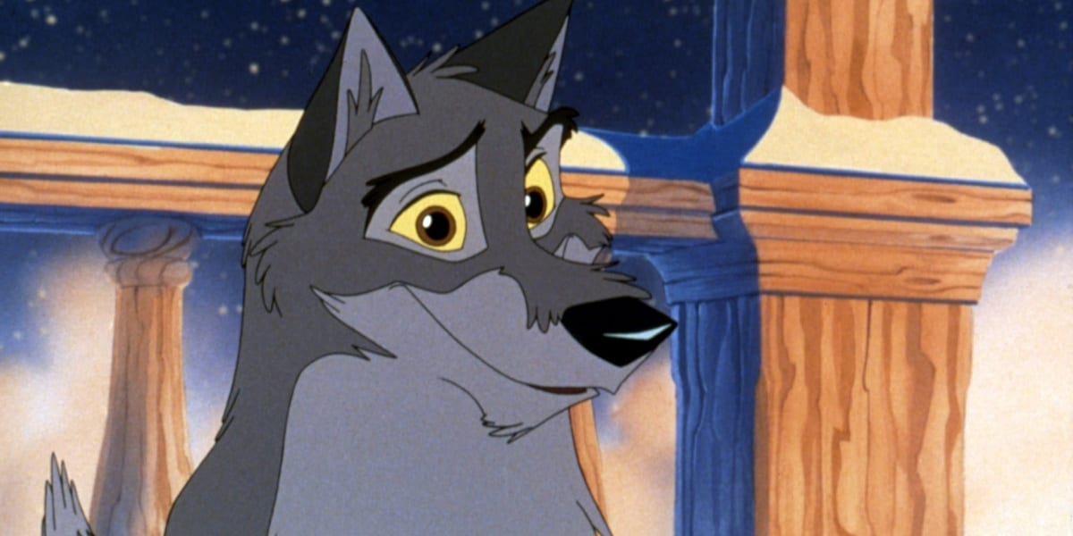 Balto looking ahead, offering a slight smile, as it snows in the background, a railing also visible behind him in 1995 film