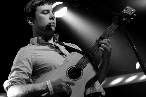 Bill Callahan on stage with acoustic guitar