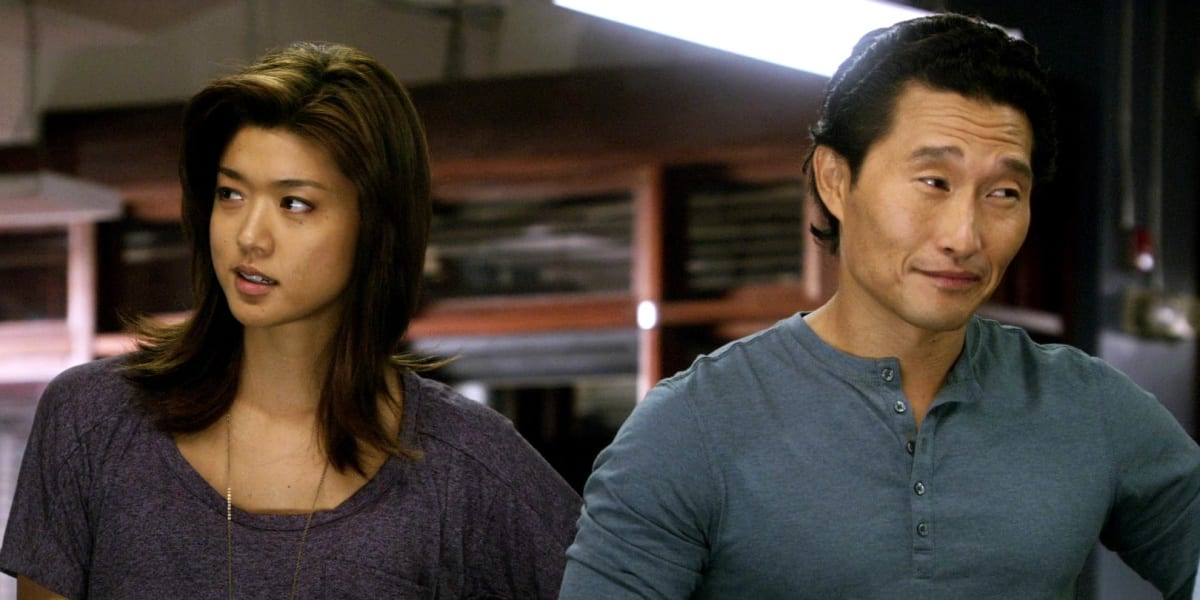 Chin looking to his left with a small smile, and Kono looking to her right, Chin wears a blue shirt and Kono a purple shirt