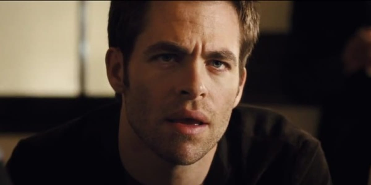 Chris Pine looking ahead and slightly above him in shock, furrowing his eyebrows and his mouth half open in People Like Us