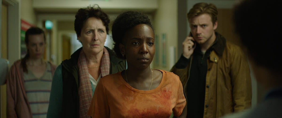 """Tamara Lawrance as """"Charlotte"""", Fiona Shaw as """"Margaret"""" and Jack Lowden as """"Thomas"""" standing"""