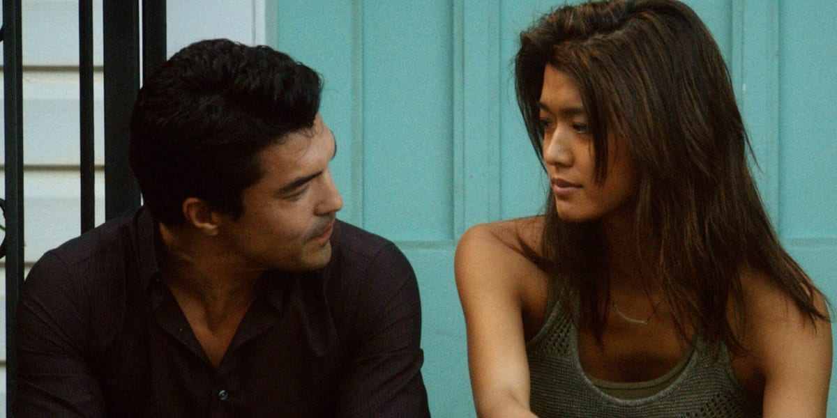 Kono and Adam sitting on steps, looking at one another, Kono on the right and Adam on the left Hawaii Five-0