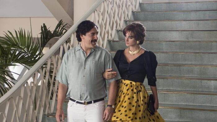 Pablo escorts Virginia down a staircase.