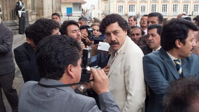 Pablo Escobar finds himself uncomfortably surrounded by members of the media.