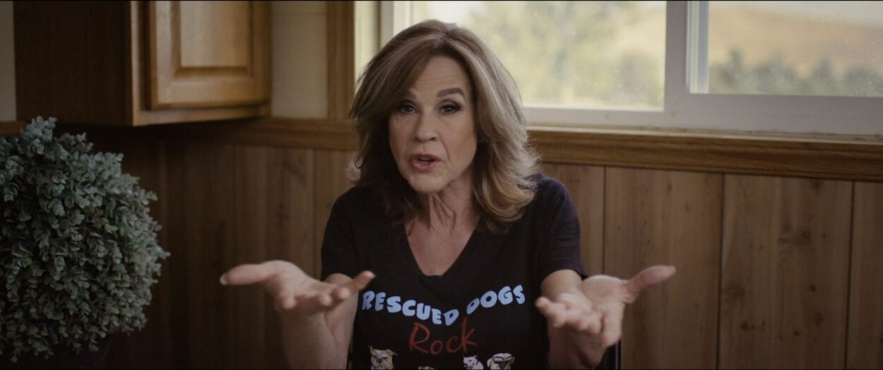 Linda Blair shrugging her shoulders as she tells a story on the set of Cursed Films.