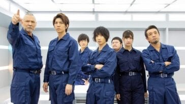 The Seafood Monster Attack Team (SMAT) poses in their blue jumpsuit uniforms.