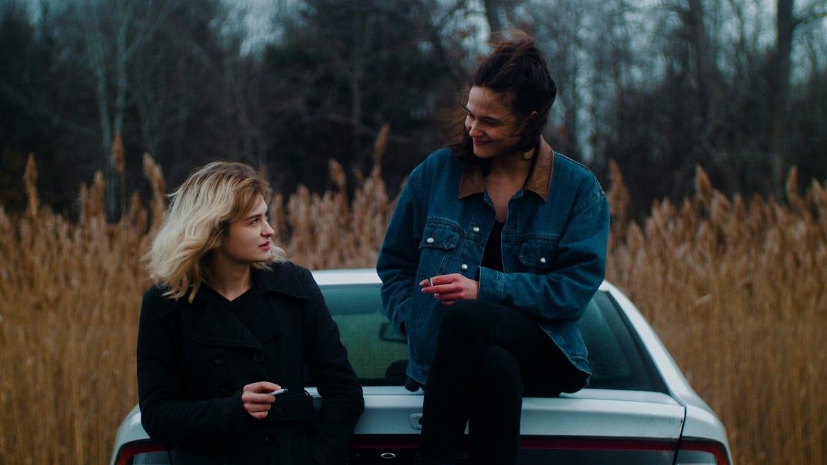 Sylvia and Alex take a smoke break, delving into some conversation.
