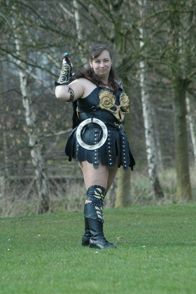 Xena cosplayer reaching for her sword