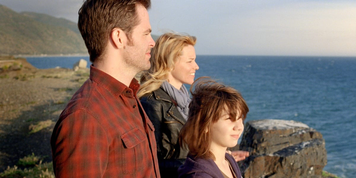Chris Pine, Elizabeth Banks and Michael Hall D'Addario standing on a cliff and looking out at the water, sun shining on them, in People Like Us