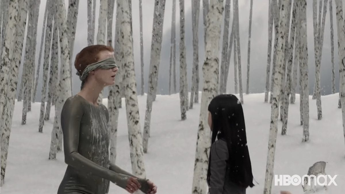 Mother, blindfolded, kneels before Vita in a snowy forest simulation