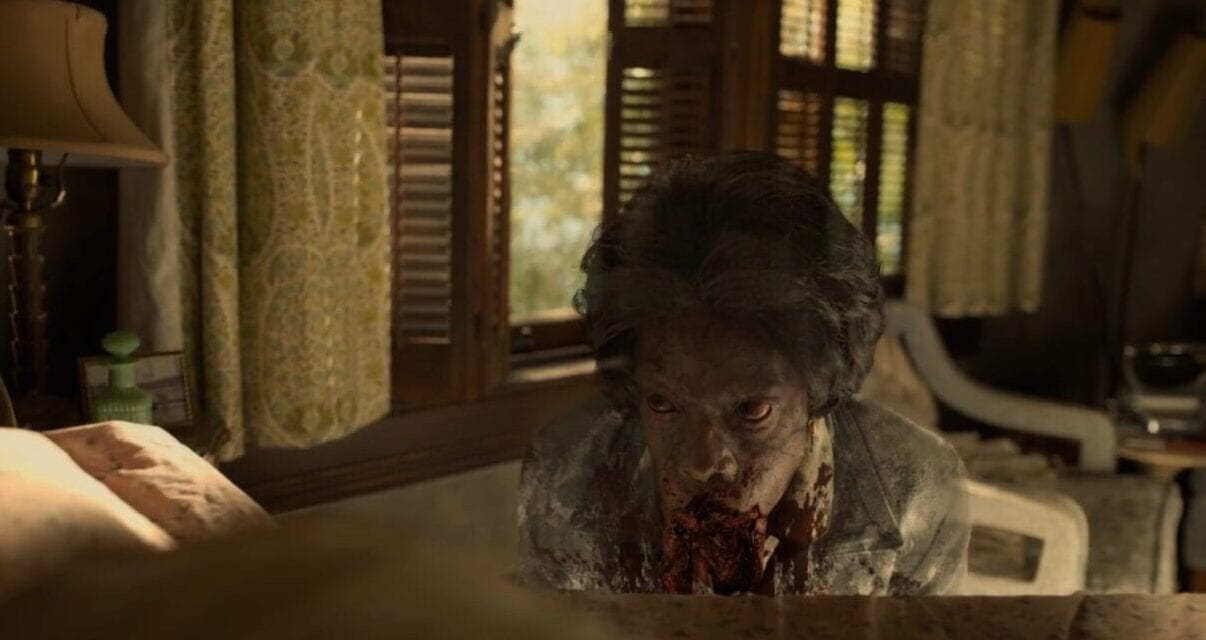 a horrific woman ghost with blood pouring from her mouth