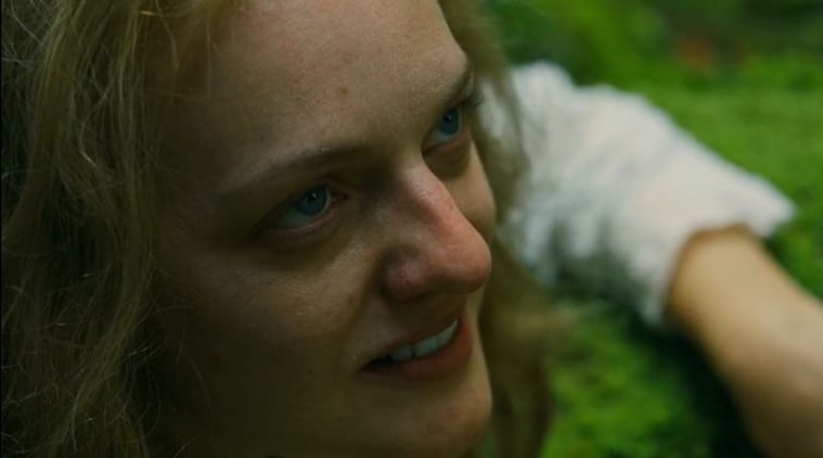 Extreme close-up of Shirley (Elisabeth Moss) grinning up at Rosie (Odessa Young)