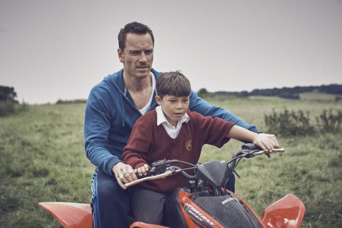 Chad shows his son how to steer an ATV.