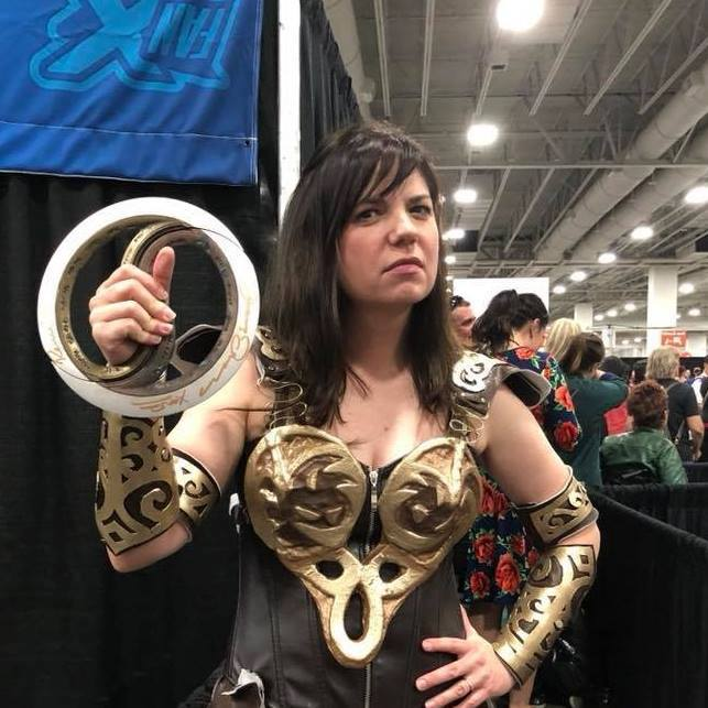 A Xena cosplayer holds up her chakram