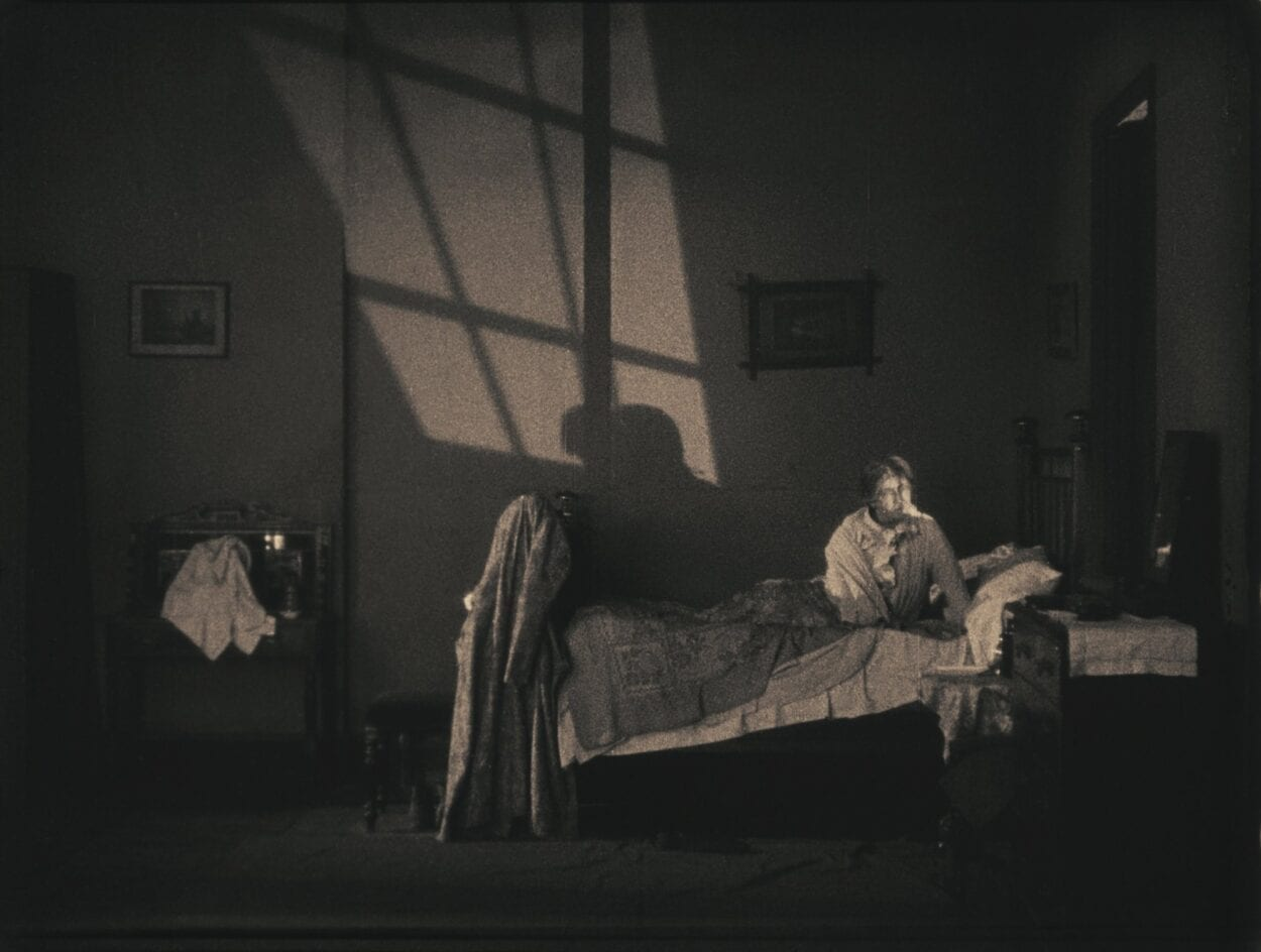 Mrs. Bunting sits up awake in her room
