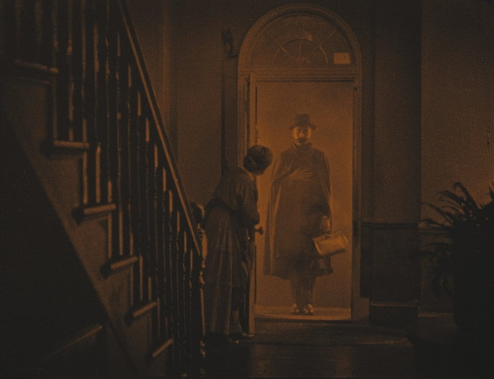 The lodger stands in the doorway