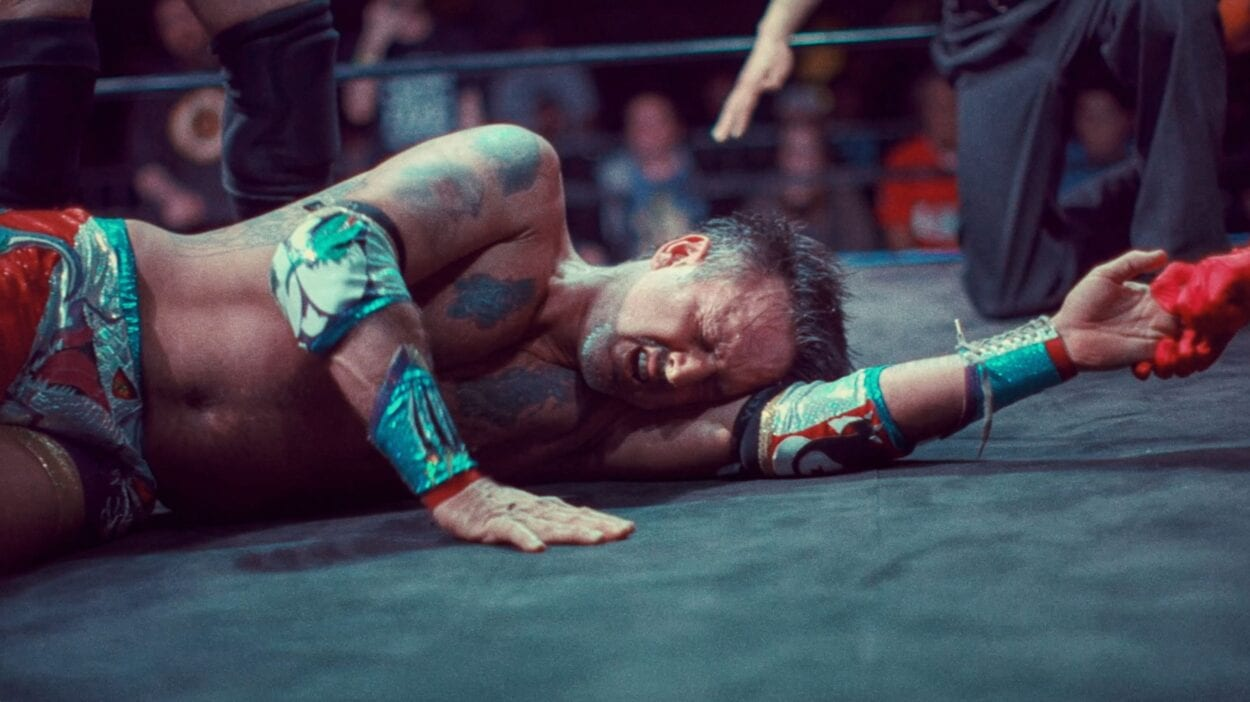 David Arquette laying in the ring, defeated.