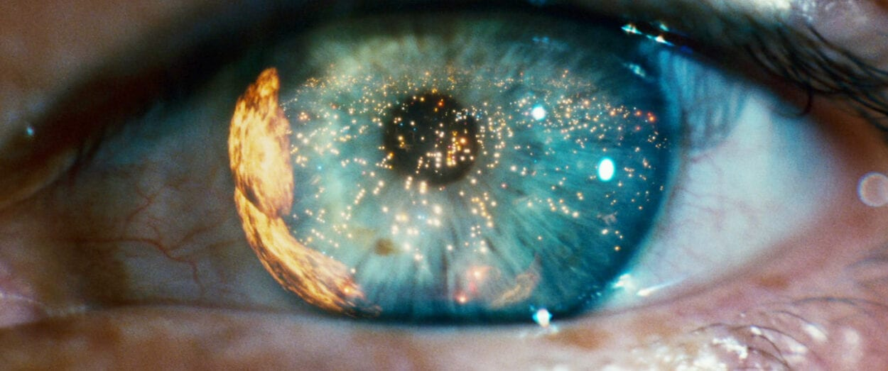 city on fire reflected in a green eye in Blade Runner