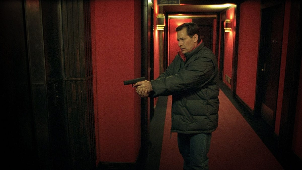 James Remar as a corrupt cop stalking a near-deserted hotel in Fear X (2003)