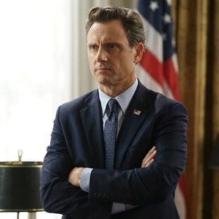 Fitz Grant in front of a flag