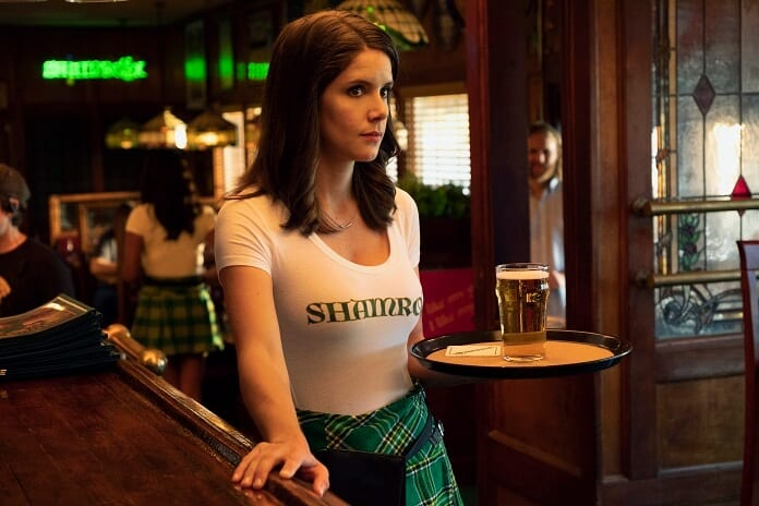 Liz waitressing at Shamroxx holding a tray with a beer