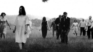 A gaggle of ghouls, men and women among them, looking disheveled and bedraggled, lurch across a field.