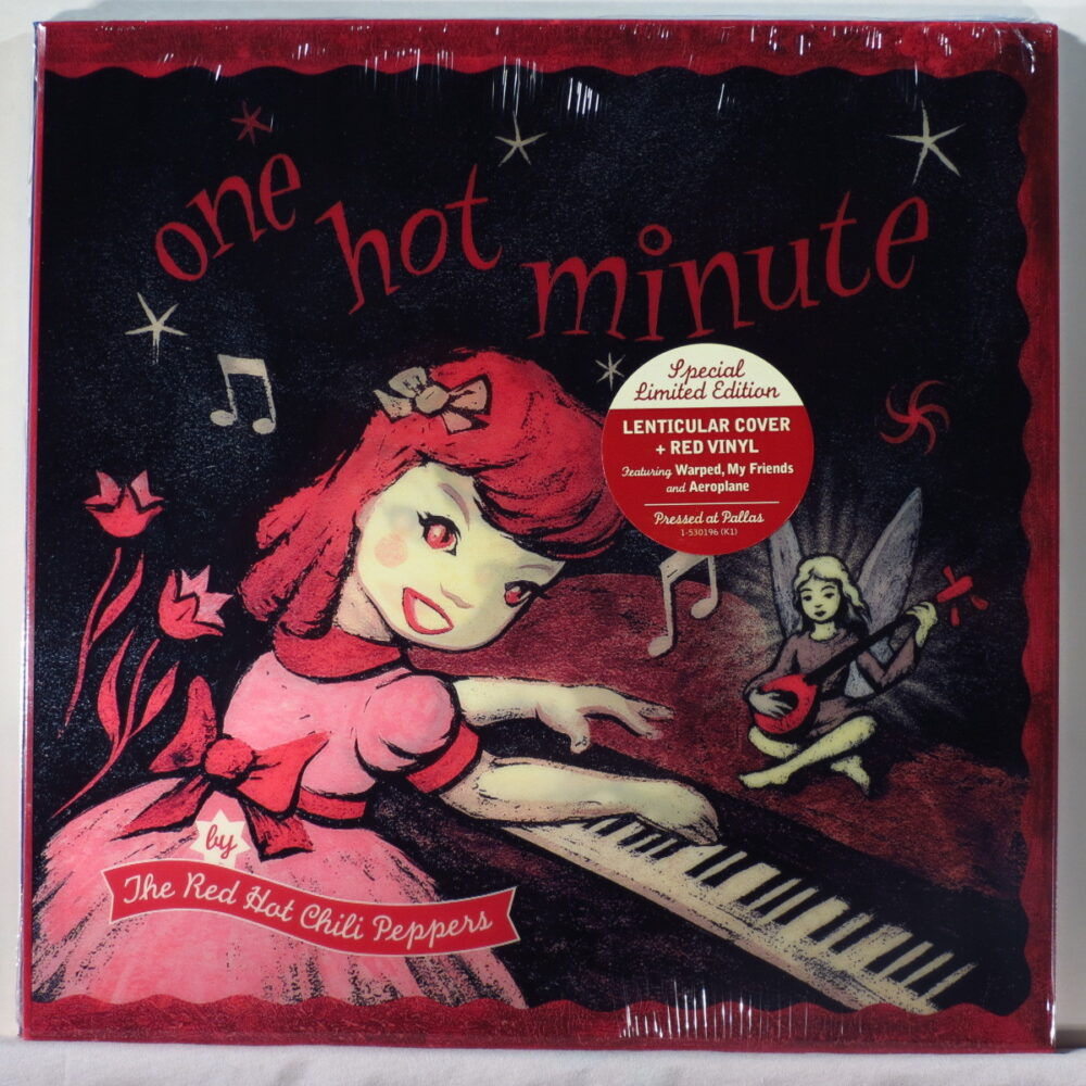 a cartoon girl with a pink dress and red hair happily turns to the camera while playing piano happily.