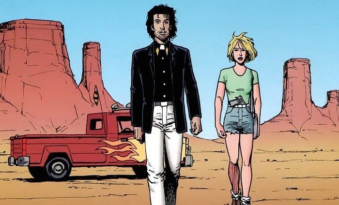 Jesse and Tulip walk through the desert away from a big red truck
