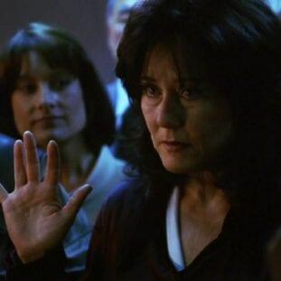 Laura Roslin raises her hand for the oath of office